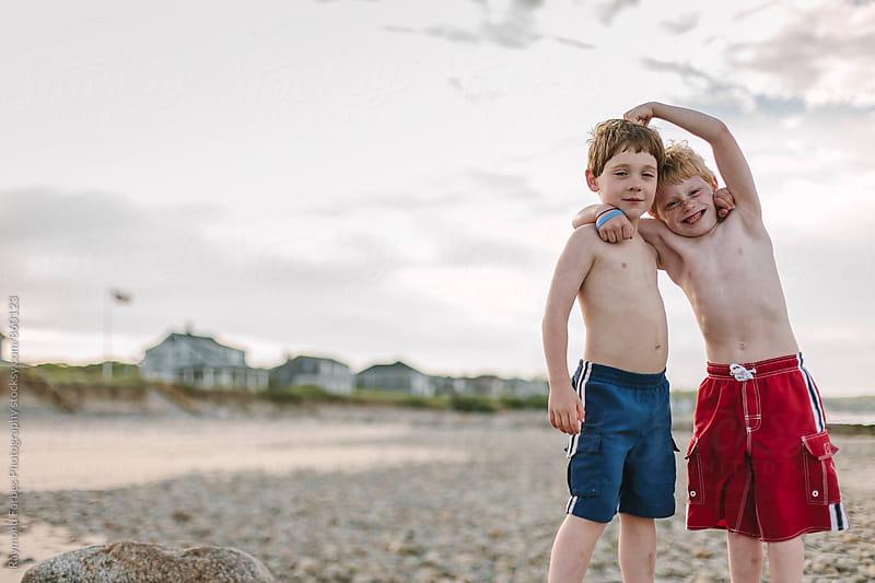 Boys having Fun on Beach by Raymond Forbes LLC for Stocksy United