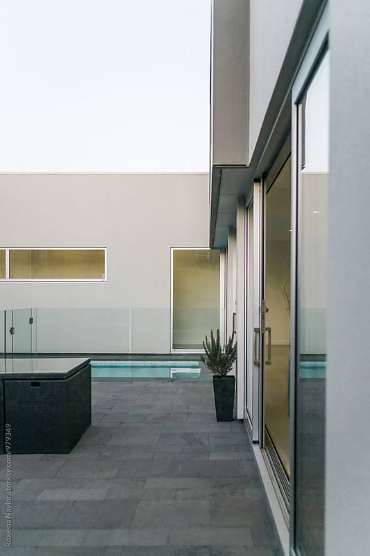 Architect designed home with plunge pool at twilight by Rowena Naylor for Stocksy United