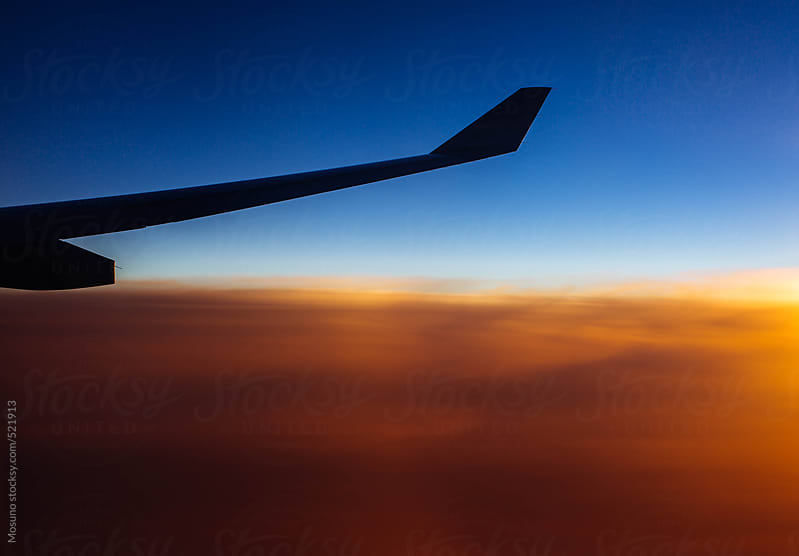 Airplane Wing at Sunset by Mosuno for Stocksy United