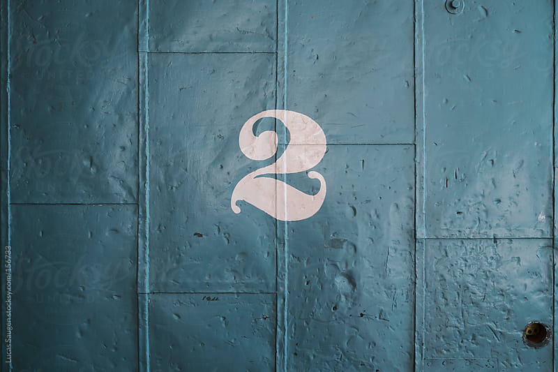 The number 2 on an old metal door. by Lucas Saugen for Stocksy United