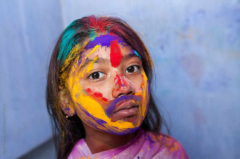 Indian Girl with colorful face in Holi festival by PARTHA PAL for Stocksy United
