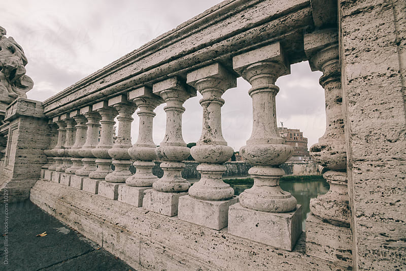 Ancient columns on a bridge in Rome, Italy. by Davide Illini for Stocksy United