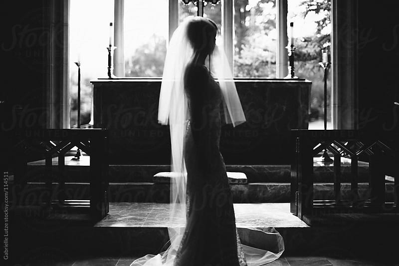 Silhouette of Bride on Alter in Black and White by Gabrielle Lutze for Stocksy United