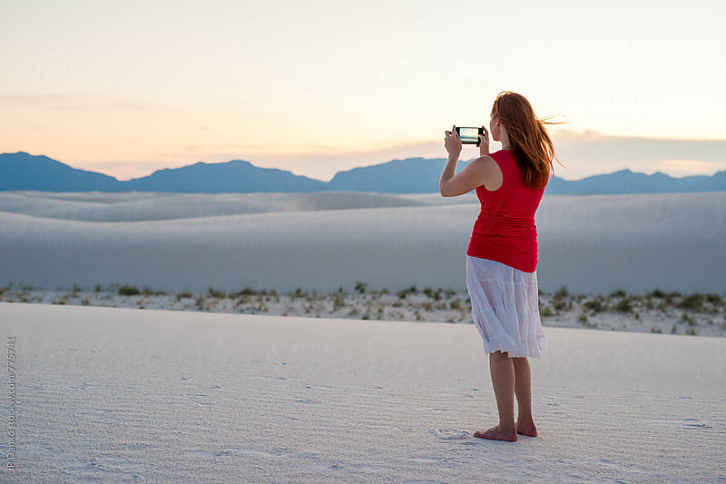 Woman Taking Photo With Phone Camera of White Sand Dunes In White Sands National Monument New Mexico by JP Danko for Stocksy United