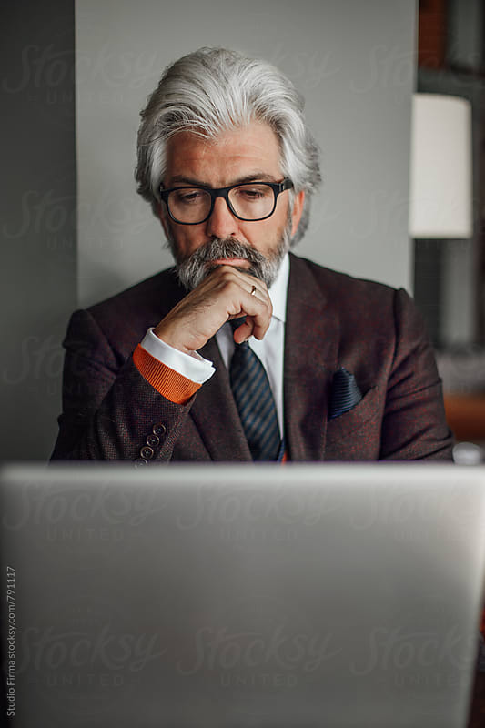 Businessman Sitting in a Cafe by Studio Firma for Stocksy United