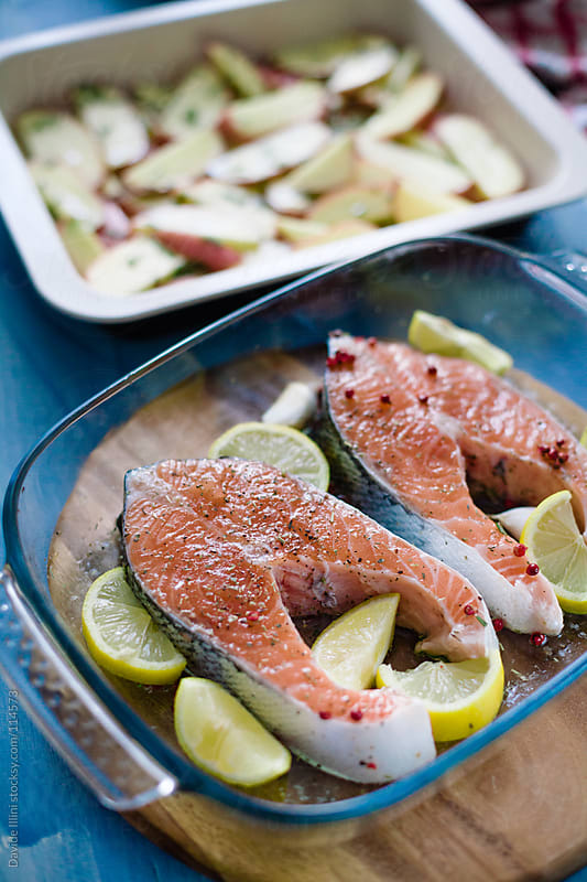 Raw salmon ready to be cooked by Davide Illini for Stocksy United