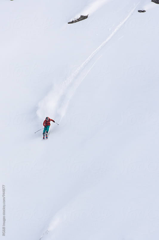 Skier riding with speed on fresh snow by RG&B Images for Stocksy United
