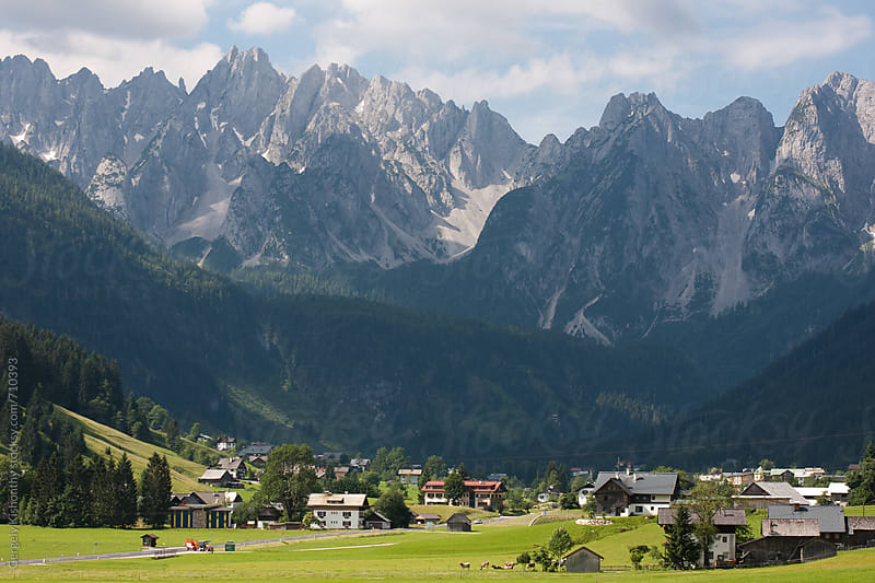 Alpine village and mountains. by Gergely Kishonthy for Stocksy United