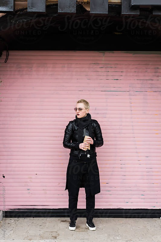 lesbian woman with beer on the street  by Alexey Kuzma for Stocksy United
