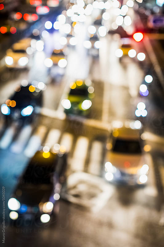 Blurred image of Traffic at night by Mauro Grigollo for Stocksy United