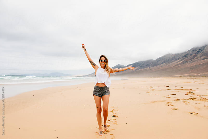 Portrait of young woman with sunglasses on a paradisiac beach by Susana Ramírez for Stocksy United