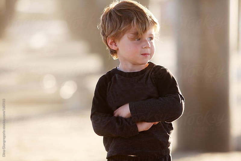 Toddler boy folding arms with attitude. by Dina Giangregorio for Stocksy United