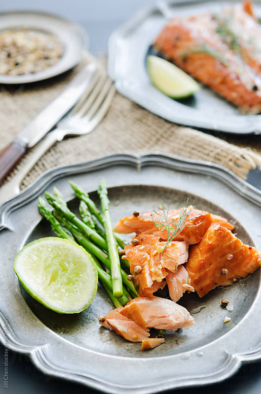 Gourmet salmon meal with asparagus and lime   by Jill Chen for Stocksy United