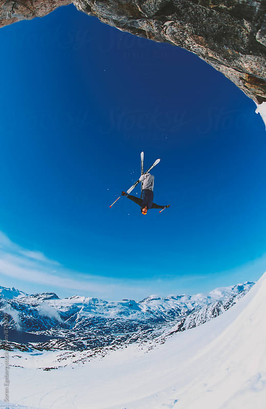 Skier jump off cliff in backflip in greenland by Søren Egeberg Photography for Stocksy United