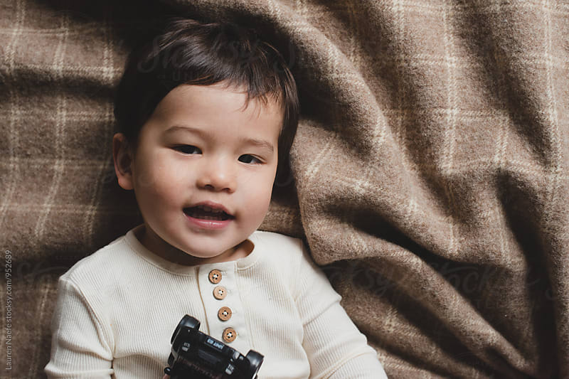 Cute little boy smiling by Lauren Naefe for Stocksy United