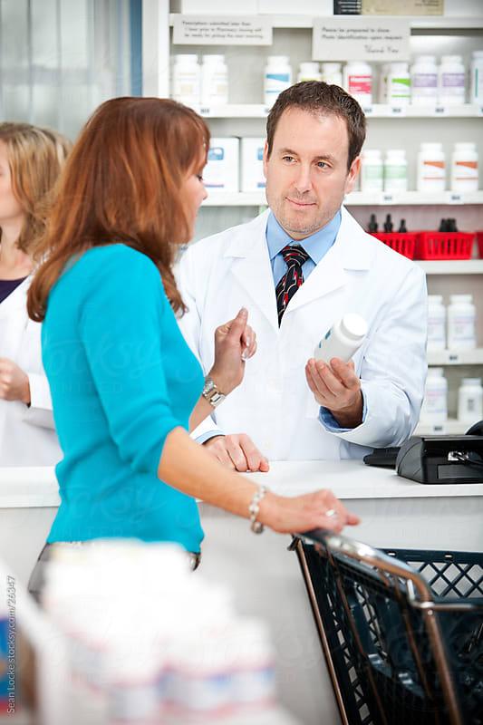 Pharmacy: Customer Asking Questions of Pharmacist by Sean Locke for Stocksy United