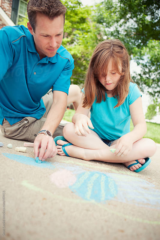Father: Drawing with Child on Driveway by Sean Locke for Stocksy United