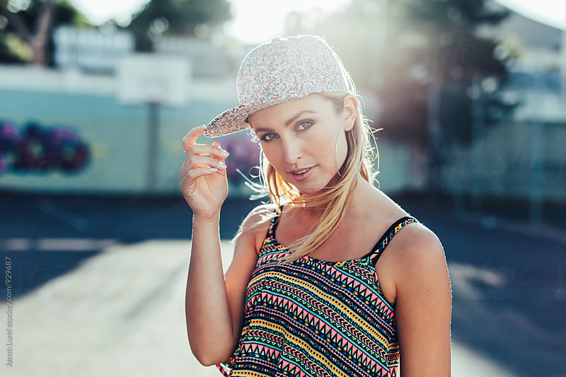 Beautiful young woman posing at camera outdoors by Jacob Ammentorp Lund for Stocksy United