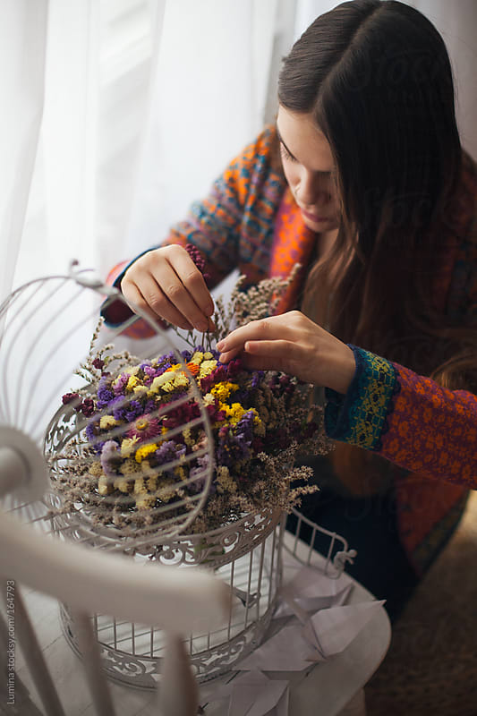 Woman Arranging Flowers by Lumina for Stocksy United