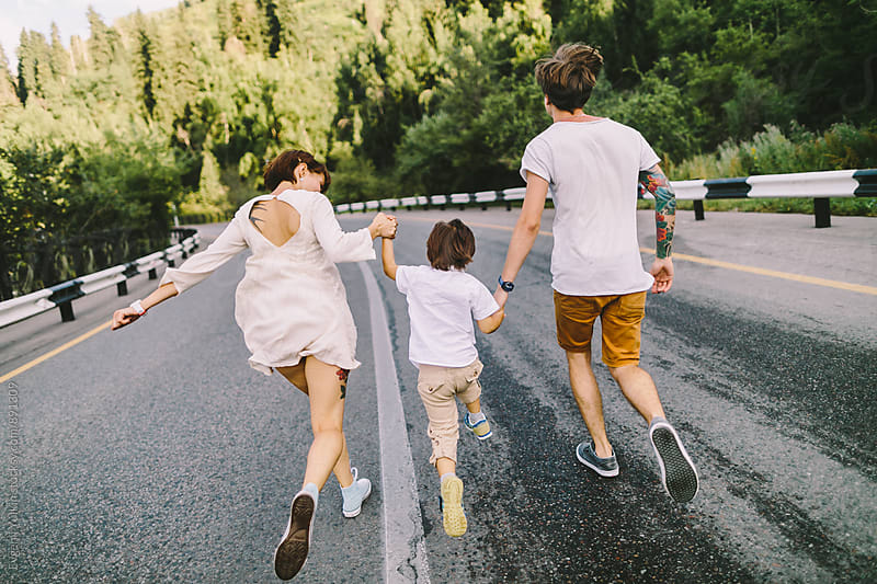 Family running away by Evgenij Yulkin for Stocksy United