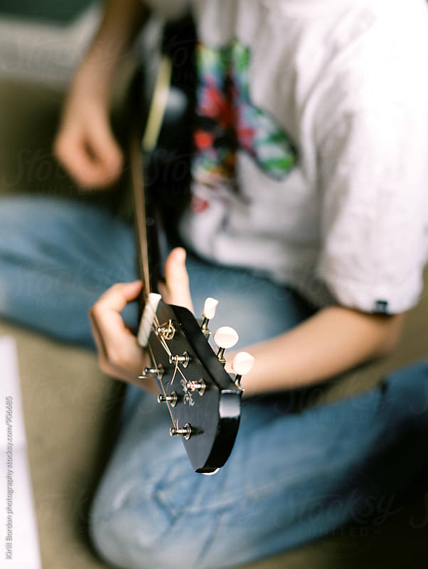 boy with guitar by Kirill Bordon photography for Stocksy United