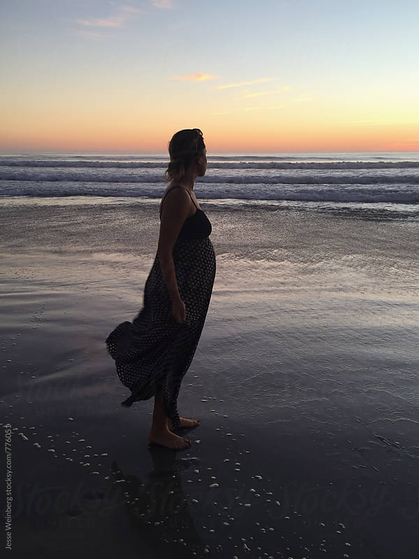 Pregnant Woman Standing Happily on Beach by Jesse Weinberg for Stocksy United