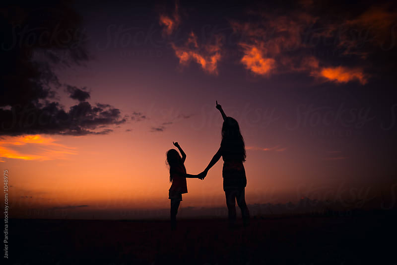 child playing with mother at sunset by Javier Pardina for Stocksy United