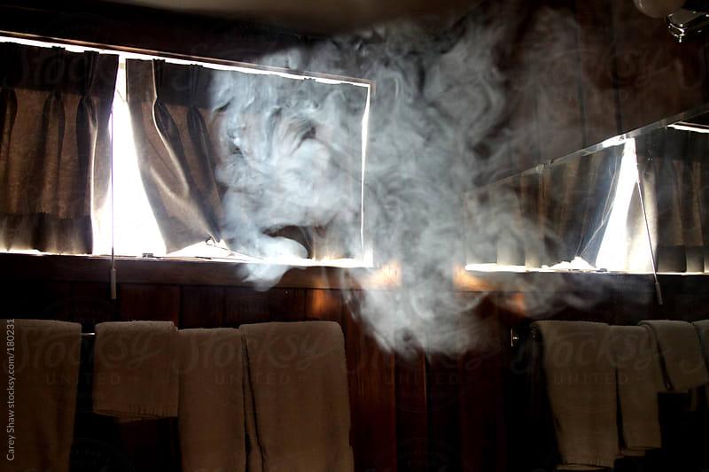Smoke floating in dark room by Carey Shaw for Stocksy United