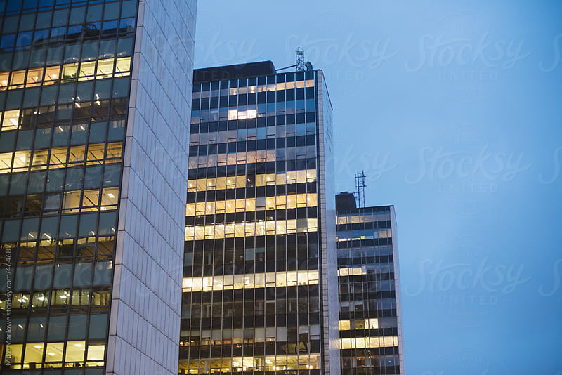 Row of office blocks in city at dusk by Mike Marlowe for Stocksy United