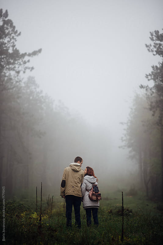 Back portrait of couple standing in the middle of forest by Boris Jovanovic for Stocksy United