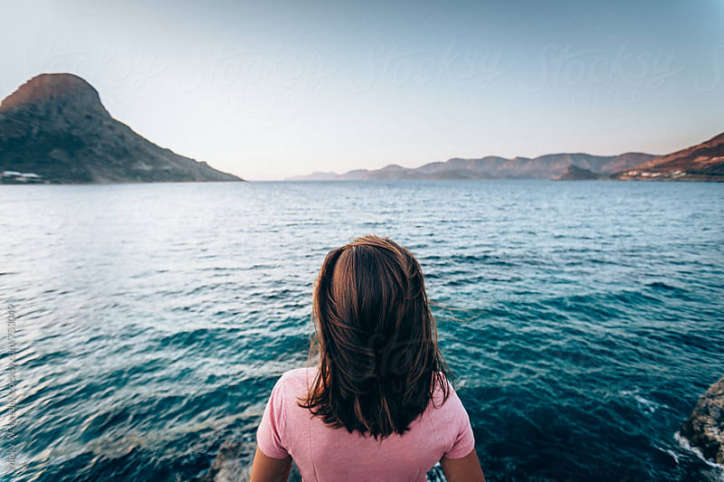 woman overlooking a scenic sea view at sunset in Kalymnos, Greece by Micky Wiswedel for Stocksy United
