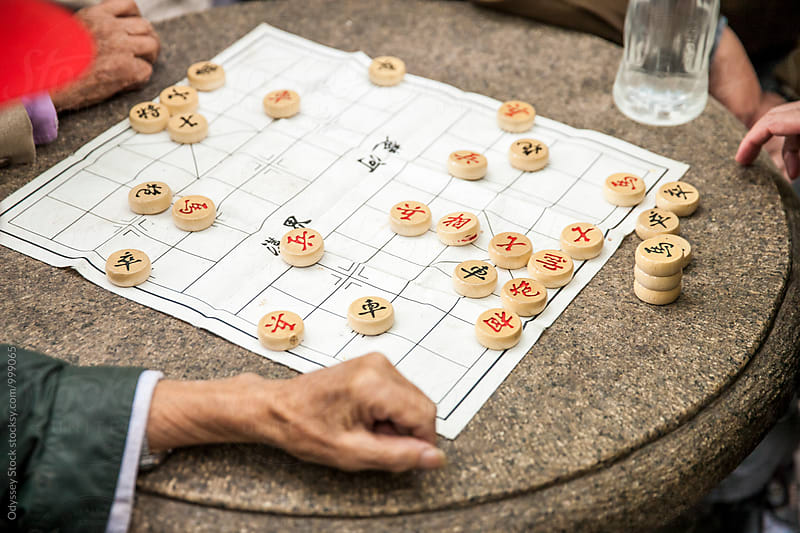 Old Men Playing Chinese Chess by Odyssey Stock for Stocksy United