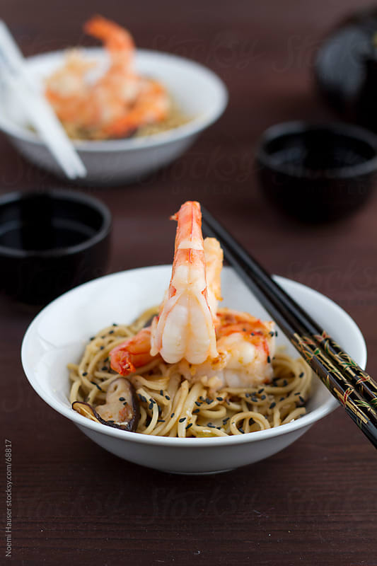 Prawn on stir fried noodles with mushroom by Noemi Hauser for Stocksy United
