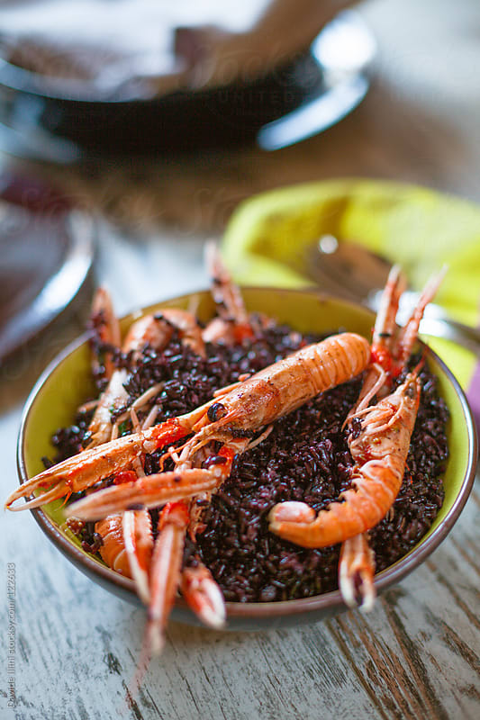 Venere rice with prawns by Davide Illini for Stocksy United