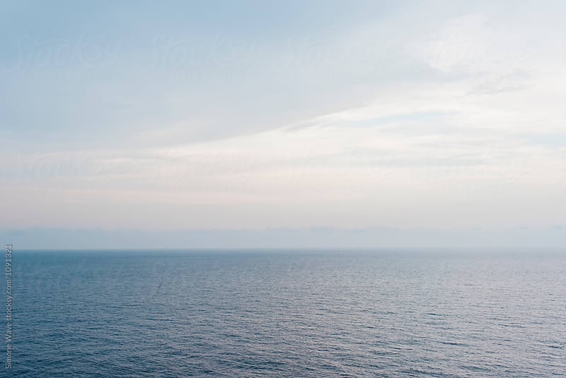 Calm sea background at sunset by Simone Becchetti for Stocksy United