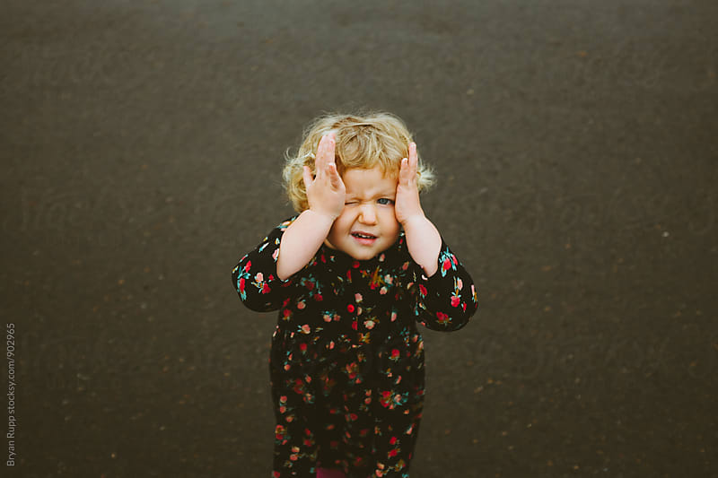 Little Girl Playing Hide and Seek by Bryan Rupp for Stocksy United