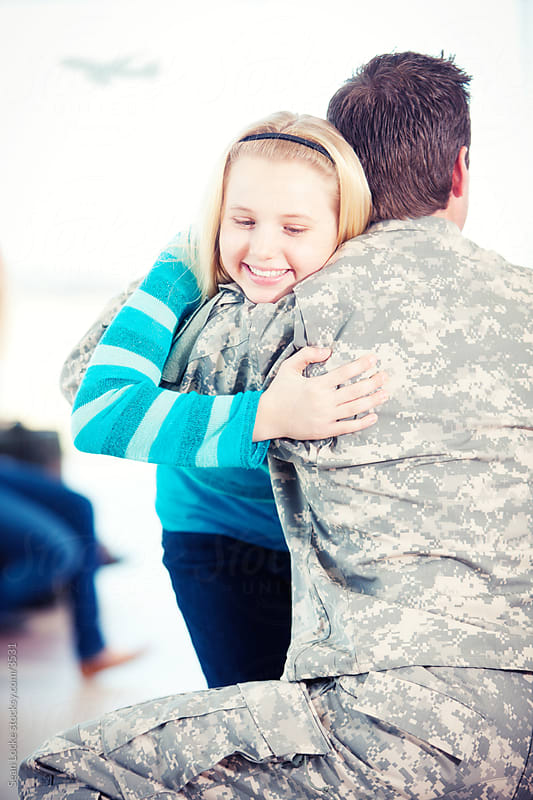 Airport: Girl Hugs Father Returning from Service by Sean Locke for Stocksy United