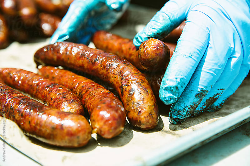 Cooking sausage by Andrew Cebulka for Stocksy United