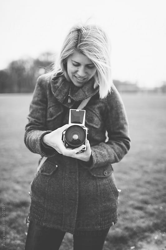 Girl with retro camera by Zocky for Stocksy United