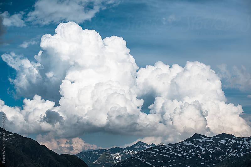 Cumulus clouds by Peter Wey for Stocksy United