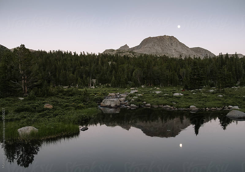 Moon rising over mountain landscape in Wyoming wilderness by Matthew Spaulding for Stocksy United