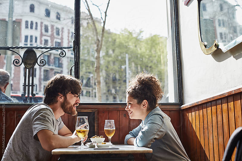 Loving Couple Sitting At Restaurant Table by ALTO IMAGES for Stocksy United