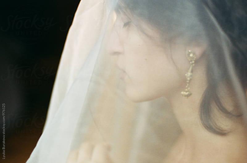 Portrait of a woman under a veil  by Lyuba Burakova for Stocksy United