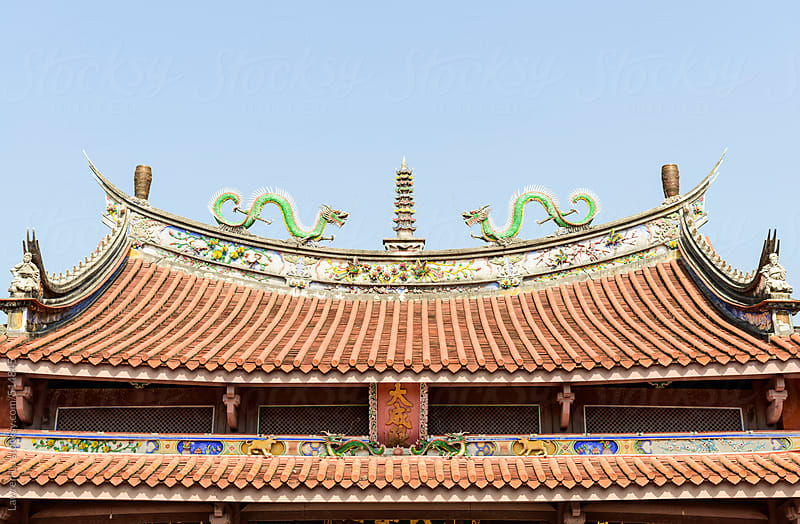 Two dragon statues on roof of temple by Lawren Lu for Stocksy United