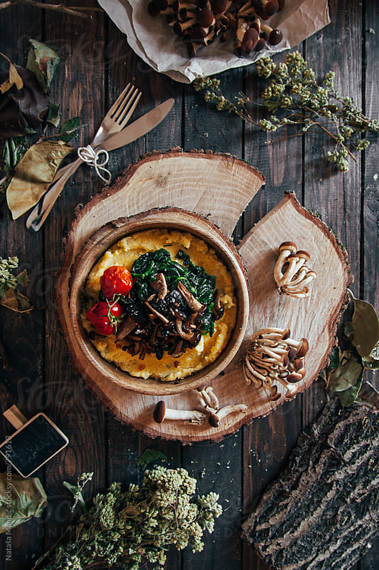 Polenta with mushrooms and roasted tomatoes by Nataša Mandić for Stocksy United