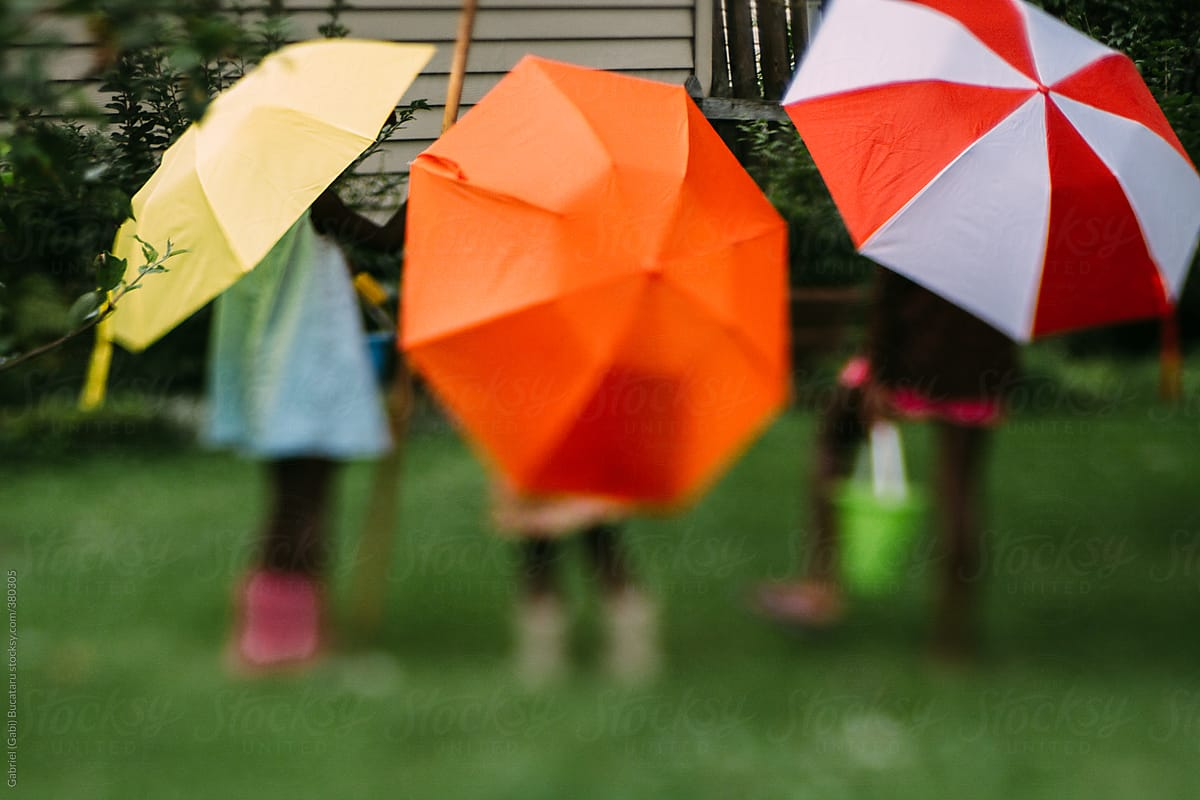Three African American Girls Playing Outside With Colorful Umbrellas ...