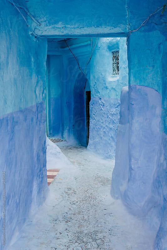 Blue walls and door in medina in Chefchaouen, Morocco by Alejandro Moreno de Carlos for Stocksy United