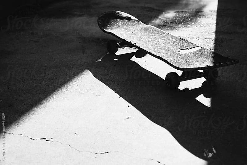 Skateboard in shadow by Curtis Kim for Stocksy United