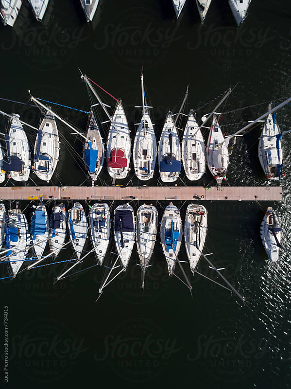 Boats and pier seen from above by Luca Pierro for Stocksy United