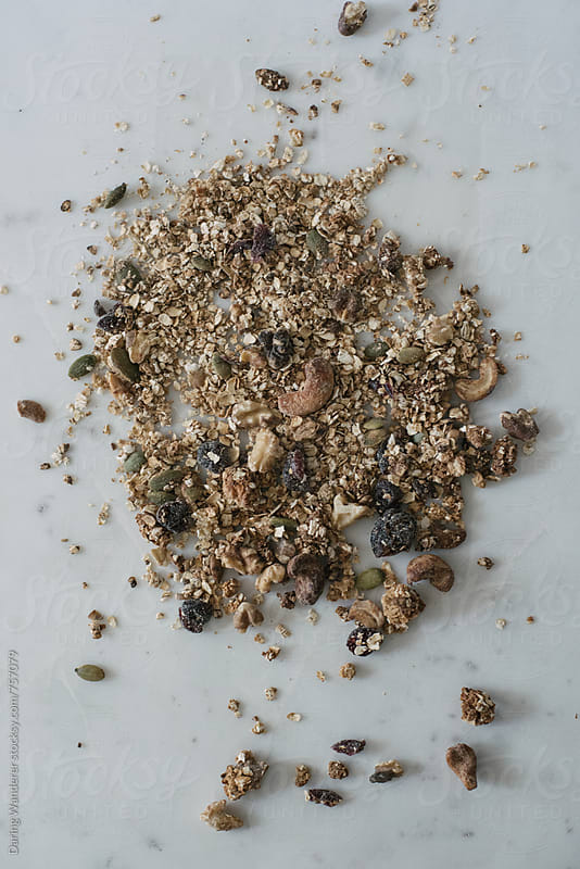 Homemade granola mixture on marble table background by Daring Wanderer for Stocksy United